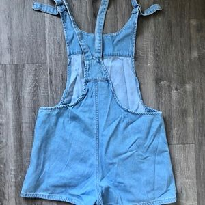 Light wash jean overalls